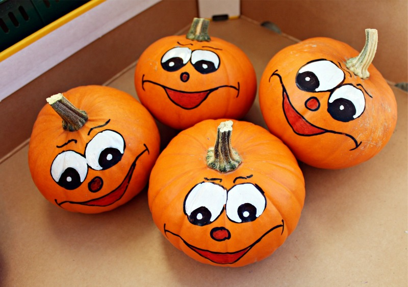 Pumpkin faces (cute faces painted on pumpkins)
