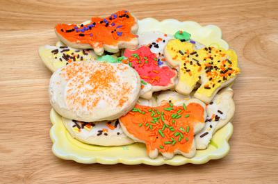 Iced pumpkin sugar cookies decorated by our neighborhood kids