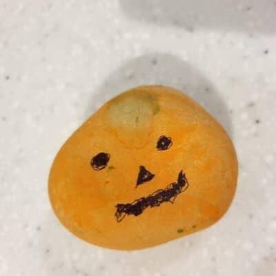 pumpkin face on rock